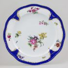 Plate - With blue scales and flower decoration