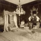Interior photograph - bedroom with a Boulle clock on the mantelpiece in the Pálffy Palace of Királyfa