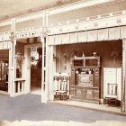 Exhibition photograph - room of craftsmen with Ödön Faragó's sideboard, Hungarian Pavilion, Milan Universal Exposition 1906